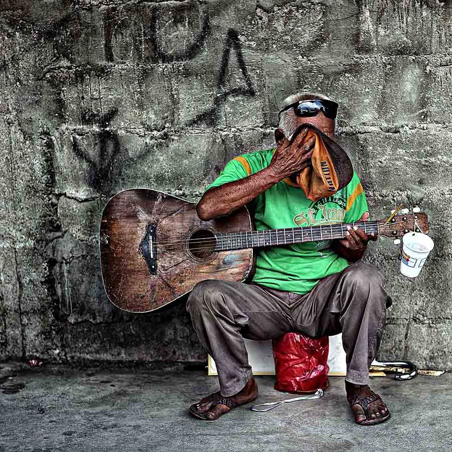tHE gUITAR MAN by Anthony Serafin - News & Events World Events