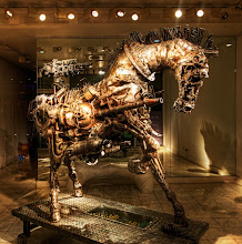 """Photo: The Steampunk Horse  I was in London and found this place just after my wife and I had a lovely dinner with Matt Ridley (have you seen his TED Talk on """"When Ideas Have Sex""""?)  Visit my Best TED Talks at http://www.stuckincustoms.com/best-ted-talks to see it... right there at the top! He's a great guy and his TED speech did not mention why ideas would come together to make a steampunk horse.  We passed a gallery in a nice part of town that was totally dark and mysterious -- except for this wonderful creation inside.  I could not resist and had to whip out the tripod to make it happen!  from Trey Ratcliff at www.stuckincustoms.com"""