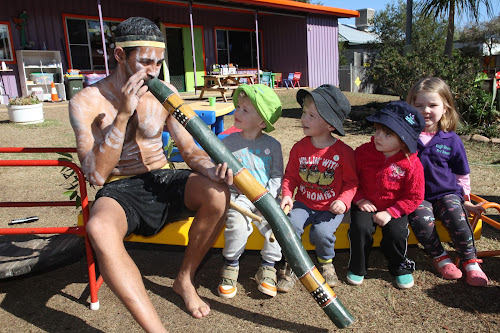 Clinton Lamb demonstrates the didgeridoo for his appreciative audience at the Kogil street Pre School celebrations on Tuesday. From left, James Thompson, Archie Thompson, Emily Ross and Willow Stanford.
