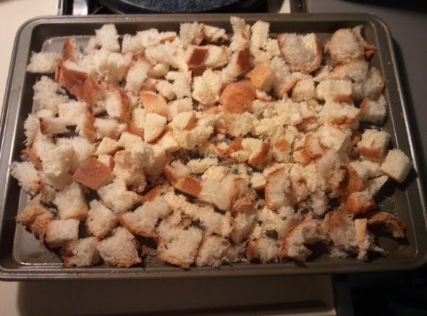 Roughly chop the breads and spread out on a cookie sheet.  Place in...