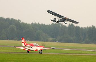 """Photo: PZL M-26 """"Iskierka"""" (na ziemi) + Piper L-4"""