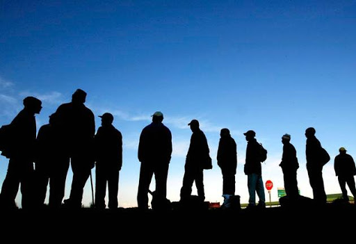 Job seekers wait for work beside the road near Cape Town's Khayelitsha township in 2003. Fourteen years later, the jobless situation in South Africa is even worse. Picture: REUTERS