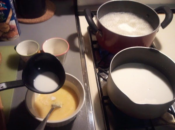 Temper eggs with hot milk: slowly add hot milk into eggs, stirring the whole...