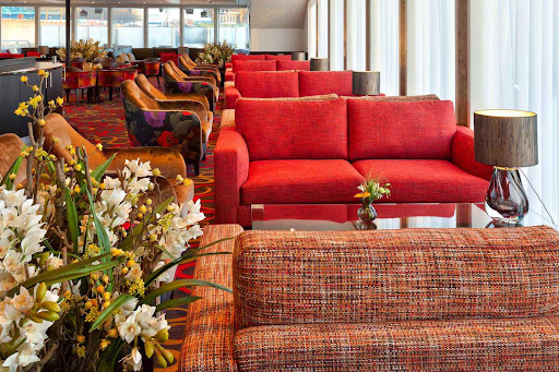 Meet other guests and watch the passing landscapes in the lounge of AmaSerena.
