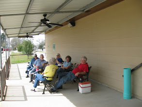Photo: Train Watchers eating lunch and talking, hardly watching at all.