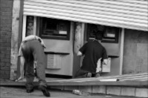 ALMOST BLASTED: The two ATMs that were nearly bombed at Zola in Soweto. Pic. Peter Mogaki. 15/05/08. © Sowetan.