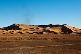 Photo: The Sahara desert - it looked like clay from afar.  Merzouga - Erg Chebbi