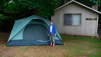 Photo: Karen with our tent and St. George