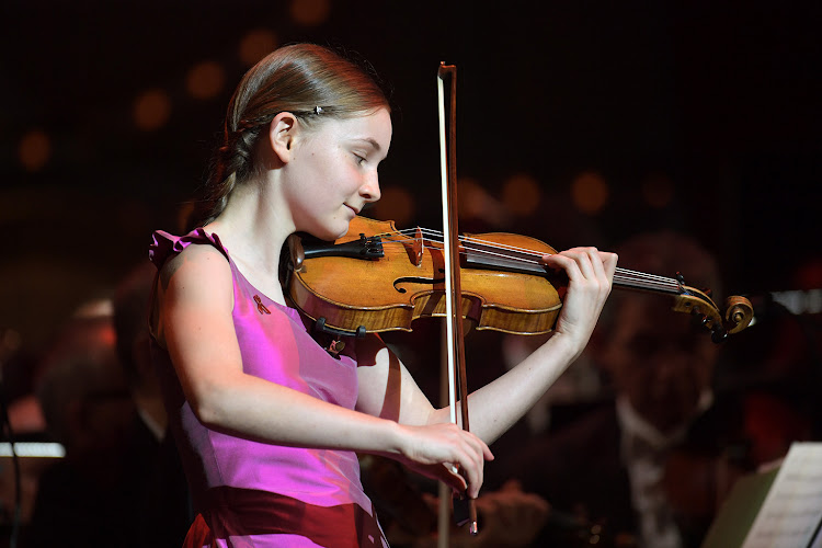Alma Deutscher performs on stage during the Life + Celebration Concert at Burgtheater