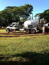 Photo: The cement truck was at the site early today. All of the trenches for the electrical and water lines for P12 and P13 were filled.