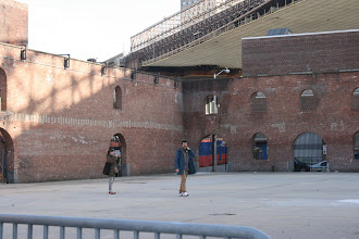Photo: A couple in the old, roofless warehouse.