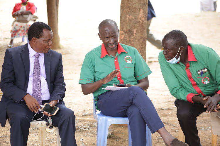 KNUT National Secretary General Wilson Sossion(centre) consults with Baringo branch reelected Executive Secretary Joshua Cheptarus(left) and Nandi North's Josphat Serem during the union's branch elections at Visa Oshwal primary in Kabarnet town, Baringo Central on Saturday.
