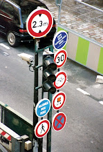 """Photo: Said the people of Paris, """"you can never have enough signs""""."""