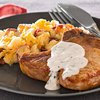 Pork Chops with Fully Loaded Smashed Potatoes.