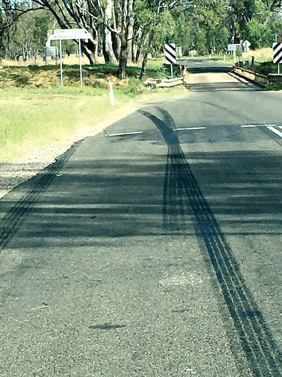 Multiple skid marks tell the story of possible disasters averted as vehicles approach the single lane Tarriaro bridge.