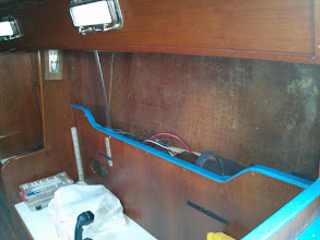 Photo: removed the textured plastic wall covering from the pilot berth area.