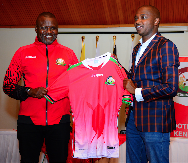 New Harambee Stars coach Jacob 'Ghost' Mulee with FKF president Nick Mwendwa during his unveiling at Safari Park Hotel on October 21