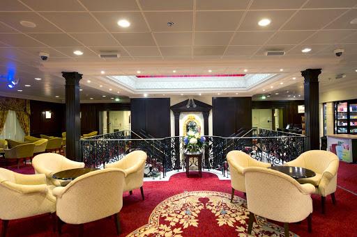 Adonia-Atrium.jpg - The atrium of Fathom's cruise ship Adonia.