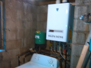 Photo: You can save a lot of space using a wall-mounted boiler unit with built in hot water heater.