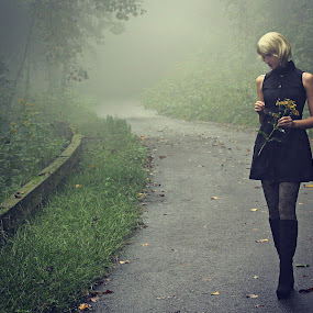 Long Walk Home by Freda Nichols - People Street & Candids ( walking, fog, woman, blond, road, flowers, , path, nature, landscape )