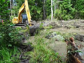 Photo: A 100 Series Excavator is used to restore the wetlands from a field that had been created from draining wetlands years ago.