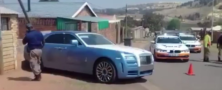 Stolen Rolls Royce surrounded by police.