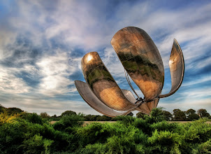 Photo: Solar Flower - The Giant Robotic Flower of Buenos Aires  This thing is enormous. In grinds and churns as it follows the sun. The metallic petals flex and bend with the light as the sun sweeps across the sky. I had never seen anything so huge and steampunk in my life.  I walked around it for a while to get a good angle of the monster. My tripod was stuck in customs, so I had to do this one handheld... and do my best to keep the camera as steady as a T-1000.