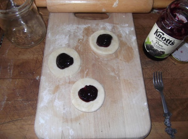 Place 1/4 tsp. of jam in center, fold in half and crimp edges with...