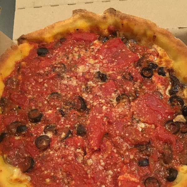 GF Chicago deep dish, VERY delicious, couldn't stop eating it....lol They didn't skimp on a thing. The rest of my family ordered their traditional pizza and calzones and they loved it all. Great place if you are GF or need a place that can cover all family members 😎