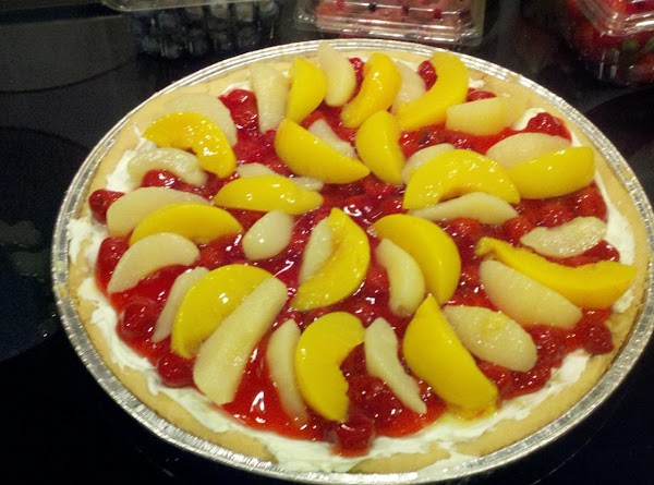 Place the slices peaches next beside the pears with all the slices facing the...
