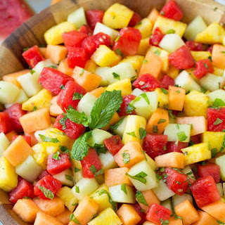 Melon Fruit Salad with Honey, Lime and Mint Dressing.