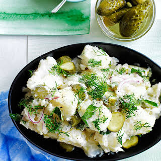 Old-school German-style crushed potato salad with dill pickles.