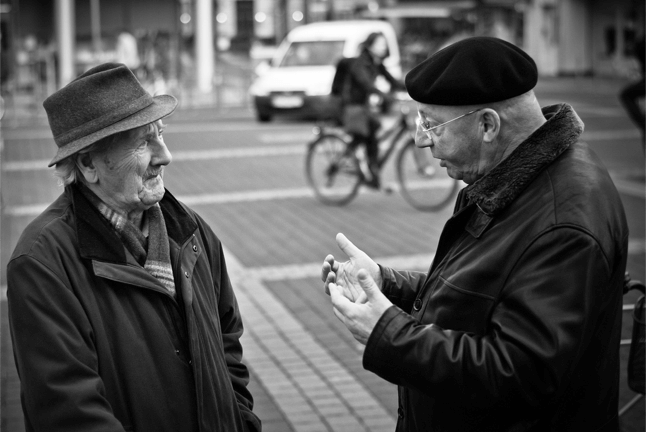 Two old people having conversation
