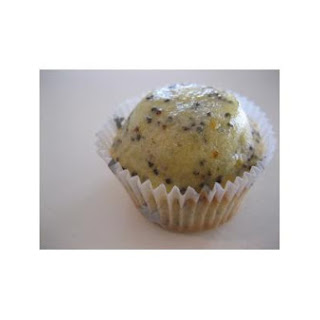 Orange and Poppy Seed Cupcakes With Passionfruit Butter Cream.