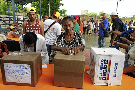 A woman casts her vote at a polling station during an unofficial plebiscite against President Nicolas Maduro's government, in Maracaibo, Venezuela, on July 16 2017. Picture: REUTERS