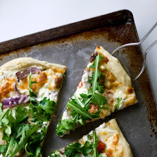 Goat Cheese Pizza with Arugula and White Sauce
