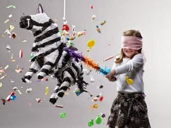 Child breaking pinata