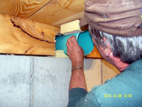 Photo: ... insulating the pipe from the concrete where it passes thru the 6 x 8 band joist.