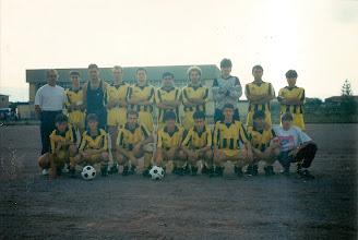 Photo: 1990-91 ΑΕΚ Α' Κατηγορία ΕΠΣ Κοζάνης. Ορθιοι: Θόδωρος Μανδραβέλης (προπονητής), Γιάννης Μούτος, Γιάννης Γκούντας, Βασίλης Γκαντάνης, Γιώργος Βατζίκας, Χρήστος Βαξεβάνος, Ζήσης Σιδέρης, Μιχάλης Πεχλιβανίδης, Ηλίας Μπαγκατζούνης, Ιορδάνης Παπαδόπουλος.  Καθιστοί: Στέλιος Χατζηγεωργιάδης, Χρήστος Τζάρος, Ρούλης Σιδέρης, Κώστας Τσαμπούρης, Χρήστος Σιώμος, Μαργαρίτης Λουμπουτσκός, Μάκης Μαλούτας, Δημήτρης Διάφας.
