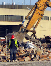 Photo: Picking metal out of the debris.