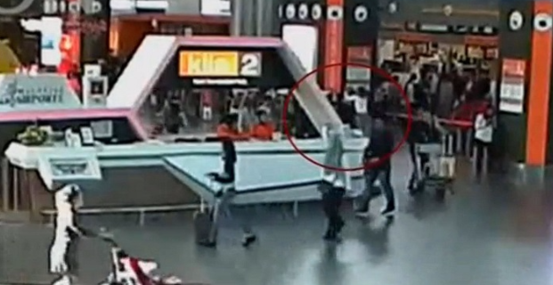 A still image from a CCTV footage appears to show (circled in red) a man said to be Kim Jong-nam being attacked from behind by a woman in a white shirt at Kuala Lumpur International Airport in Malaysia on February 13. Picture: REUTERS/FUJITV