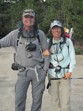 Photo: Bob and Sharon sporting bug nets at the trailhead. We all tried to eat, drink, or spit through these at some point over the weekend.