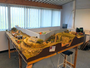 "Photo: 094 The first layout for Part 2 is another American one, this time in HOn30 (9mm gauge) and is owned by well known Slim Gauge Circle member John Spratley, who was tinkering with screwdriver under the layout when I took the photo! The eagle-eyed will be able to spot where I managed to ""paint"" him out of the scene and camouflage him as a piece of the carpet !"