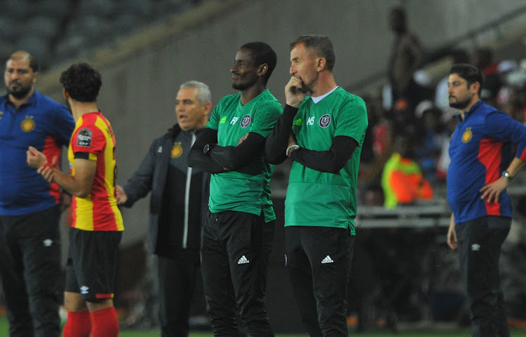 Orlando Pirates head coach Milutin Sredojevic (R) and his assistant Rulani Mokwena (L) during the CAF Champions League match against Esperance at Orlando Stadium on February 2 2019 at Orlando Stadium.