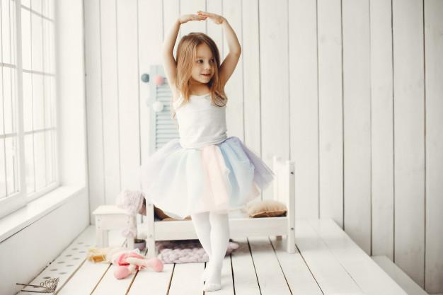Cute little girl dancing at home Free Photo