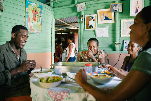 DR-Travelers-Dining-with-Locals.jpg - Dine with locals, if you wish, as part of an impact travel cruise.