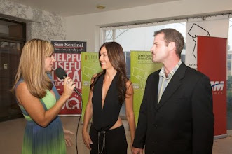 Photo: Lilian Being interviewed at the Red Carpet (in the picture with husband Scott Maguire)