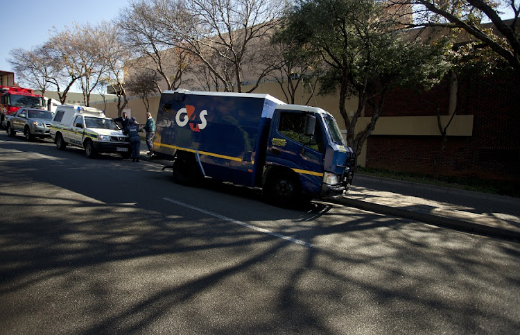 Police investigate a cash-in-transit heist in Hyde Park, Johannesburg, in 2011. Picture: THE TIMES