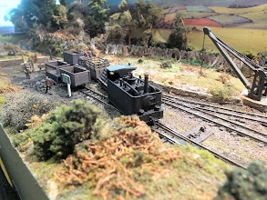 "Photo: 023 The Beyer Peacock tram locomotive, recently purchased secondhand from the Glyn Valley, shunts the daily goods at Wood End. Note the Bagnall open wagons in the coal siding, universally known as ""bagwags"" ."