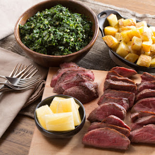 """Seared Sirloin Steaks with Roasted Potatoes & """"Creamed"""" Kale."""